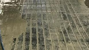straight concrete grooves in barn floor